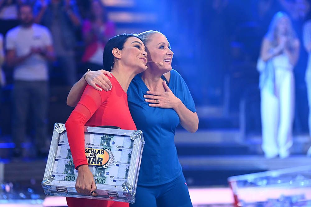 Verona mit Geldkoffer und Janine