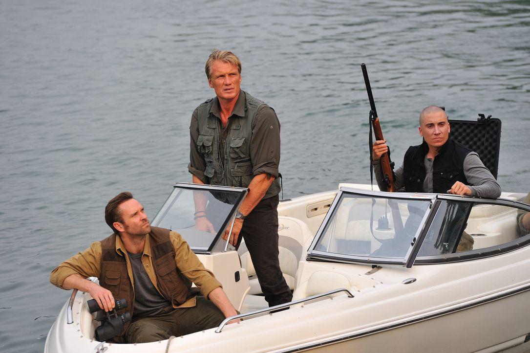 Kennen kein Mitleid mit den Kreaturen, die sie jagen: (v.l.n.r.) Chuck (Murray Clive Walker), Großwildjäger Harker (Dolph Lundgren) und Greg (Ivan K...