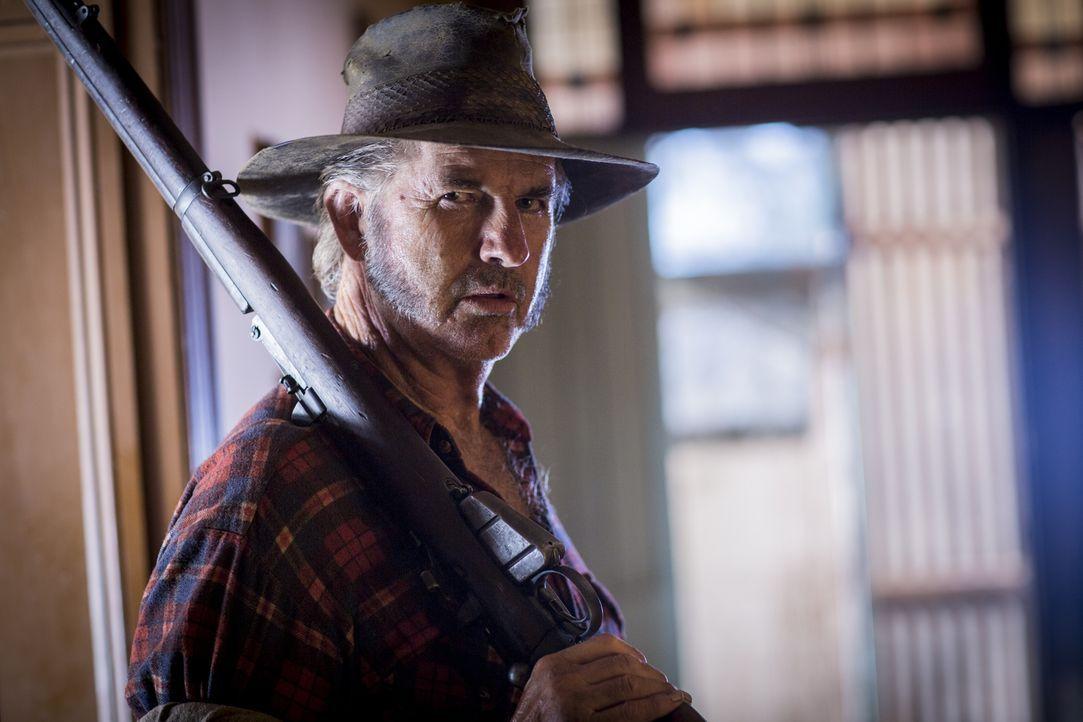 Der Wolf Creek-Killer ist zurück: Schweinezüchter und notorischer Menschenhasser Mick Taylor (John Jarratt) ... - Bildquelle: Mark Rogers 2013
