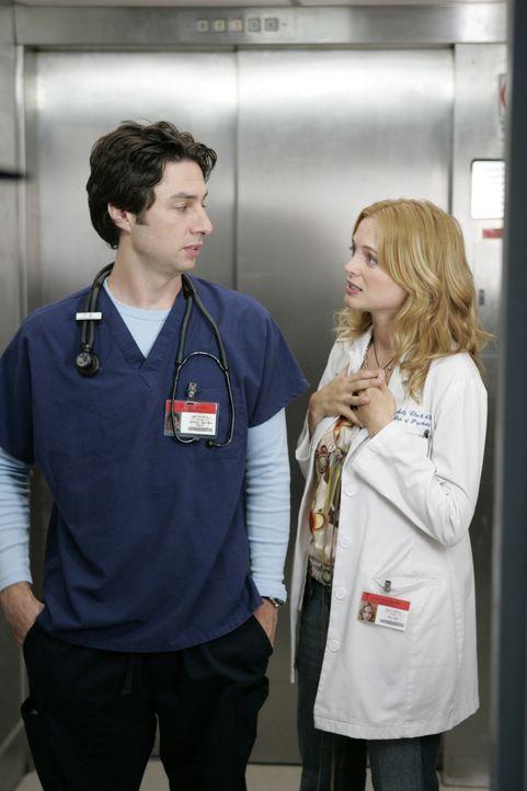 J.D.'s (Zach Braff, l.) neue leicht exzentrische Kollegin Dr. Molly Clock (Heather Graham, r.) wirbelt den Alltag in der Klinik mächtig durcheinand... - Bildquelle: Touchstone Television