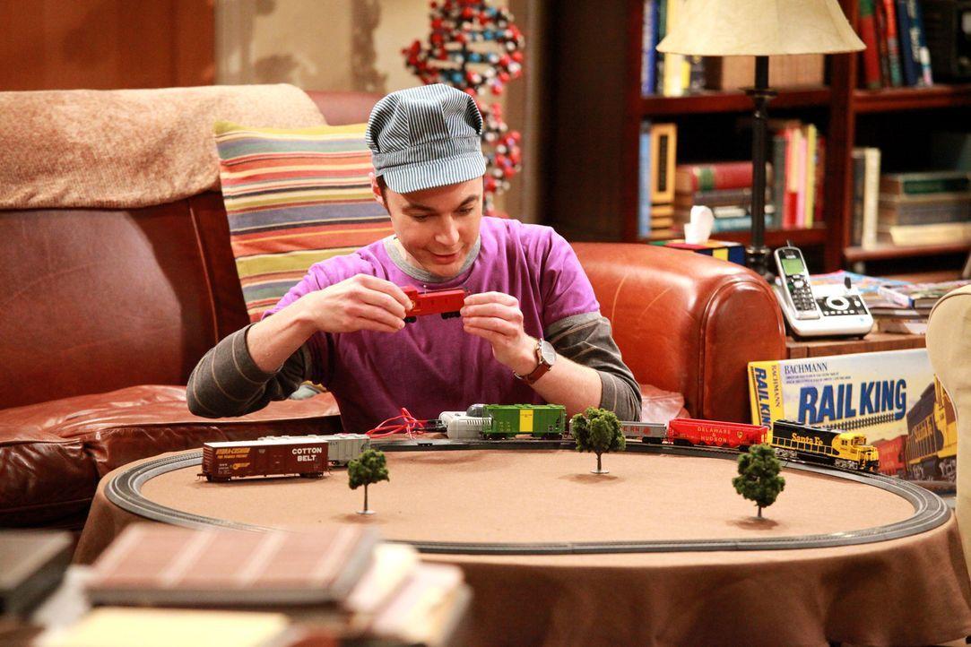 Während Sheldon (Jim Parsons) zu Hause ist, um mit seiner neuen Modelleisenbahn zu spielen, lernen sich Leonard und Amy auf einer Hochzeitsfeier bes... - Bildquelle: Warner Bros. Television