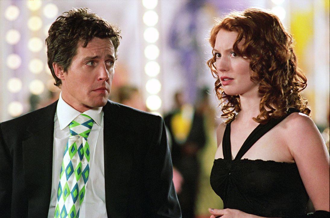 Als Lucy die Firma verlassen will, ist George (Hugh Grant, l.) über ihre Kündigung nicht glücklich, lässt sie aber gehen - unter der Bedingung, dass... - Bildquelle: Warner Bros.