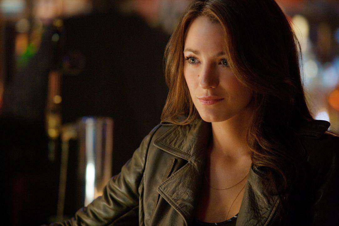 Noch ahnt die attraktive Geschäftsfrau Carol Ferris (Blake Lively) nicht, dass die Welt schon bald in großer Gefahr schweben wird und ausgerechnet d... - Bildquelle: Warner Bros.