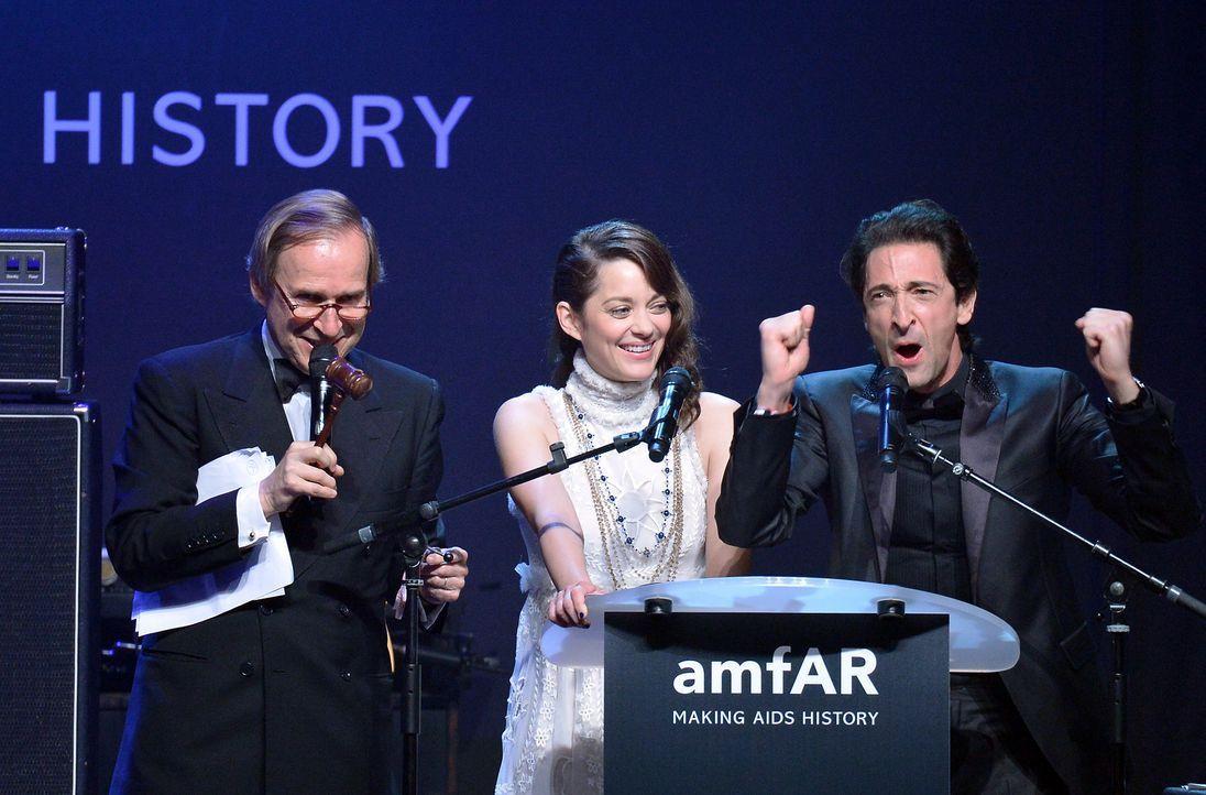 Cannes-Filmfestival-amfAR-Marion-Cotillard-Adrien-Brody-140522-1-AFP - Bildquelle: AFP