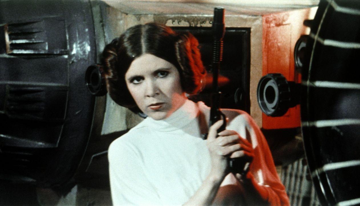 Prinzessin Leia (Carrie Fisher), die die Herrschaft über das galaktische Imperium übernehmen soll, wird von den imperialen Truppen gefangen genomm... - Bildquelle: Lucasfilm LTD. & TM. All Rights Reserved.
