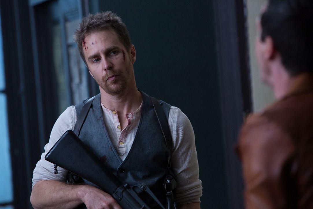 Francis (Sam Rockwell) hat viele Feinde aus seinem alten Leben, die ihn umbringen wollen. Ob er das immer verhindern kann? - Bildquelle: Wild Bunch