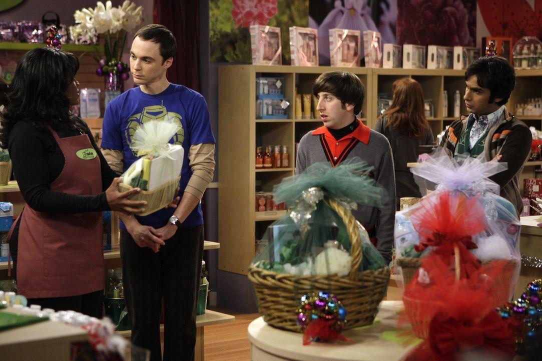 Als Sheldon (Jim Parsons, 2.v.l.) erfährt, dass Penny für ihn ein Weihnachtsgeschenk hat, möchte er sich erkenntlich zeigen und sich etwas Geeign... - Bildquelle: Warner Bros. Television