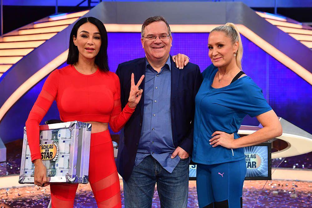 Verona mit Geldkoffer und Elton und Janine