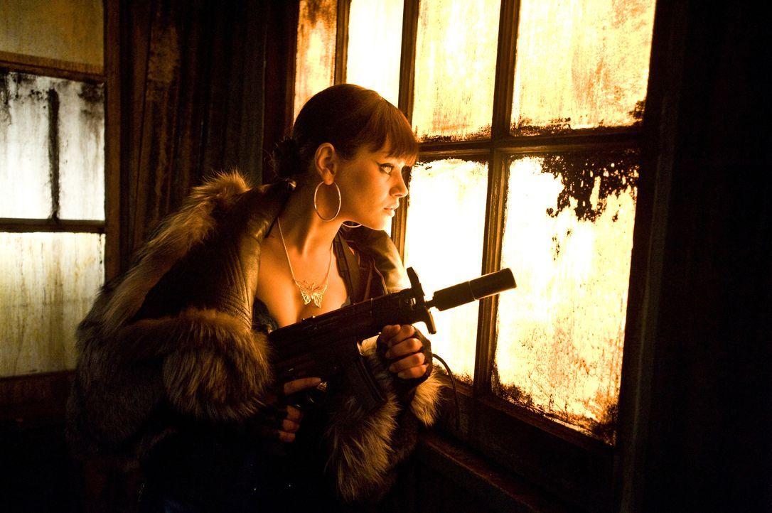 Mona Sax (Mila Kunis) - Bildquelle: 2008 Twentieth Century Fox Film Corporation. All rights reserved.