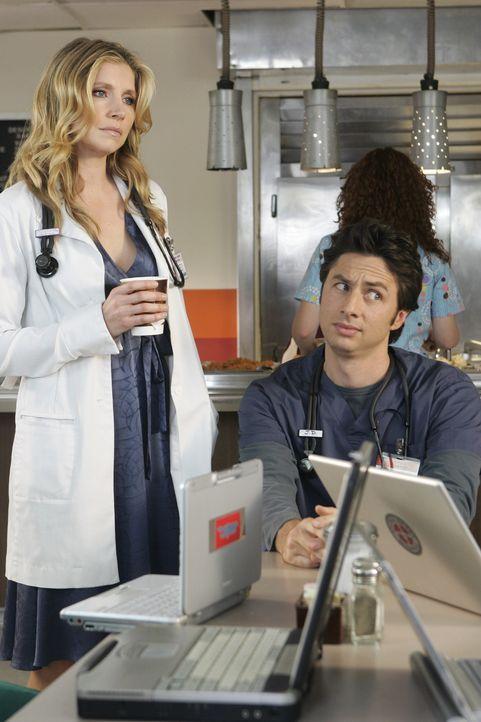 Der Wettstreit um den beliebtesten Arzt hält alle in Aufruhr: Elliott (Sarah Chalke, l.) und J.D. (Zach Braff, r.) beobachten gespannt, was sich Dr... - Bildquelle: Touchstone Television