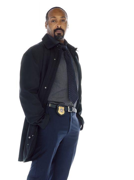 Detective Joe West (Jesse L. Martin)