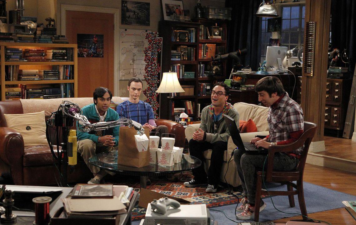 Koothrappali (Kunal Nayyar, l.), Sheldon (Jim Parsons, 2.v.l.) und Leonard (Johnny Galecki, 2.v.r.) sind begeistert von dem Roboterarm, den Howard (... - Bildquelle: Warner Bros. Television