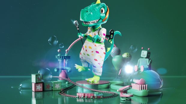 Der Dinosaurier vor grünem Hintergrund.